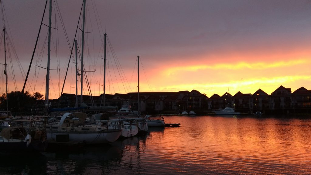 Marina with sailboats at sunset
