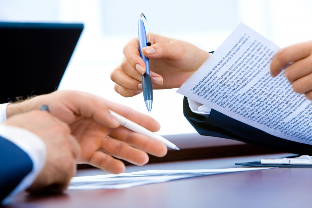 Professional office workers going through documents